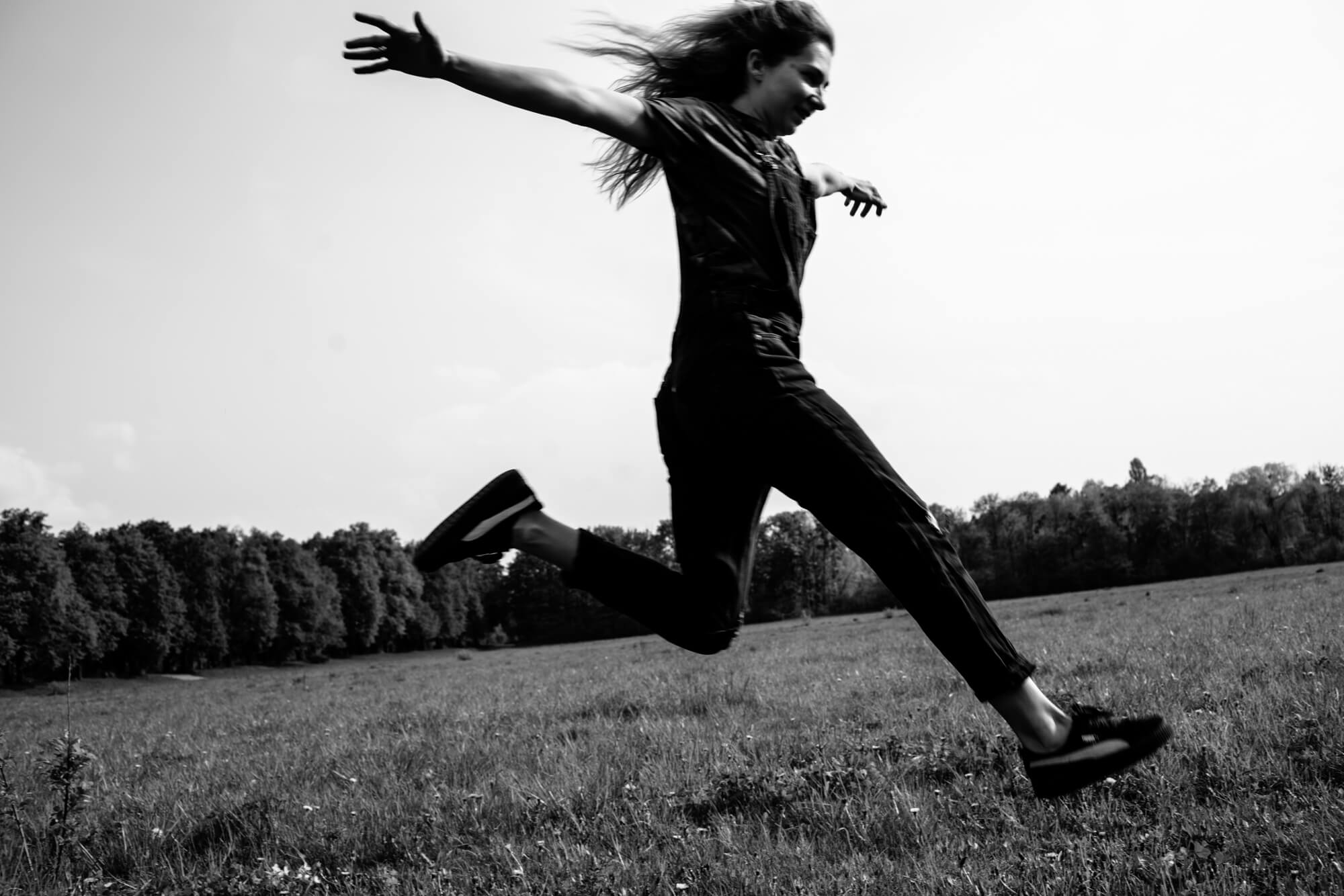 Young girl jumping in a field